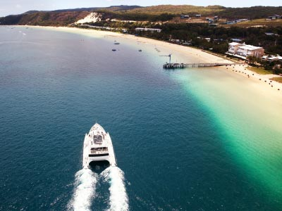 Cruise boat arriving at Tangalooma Island Resort