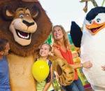 Family cuddles Madagascar movie characters at Dreamworld