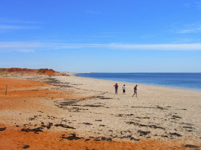 Cape Leveque, red rock dust mixes with white sand, deep blue water and sky