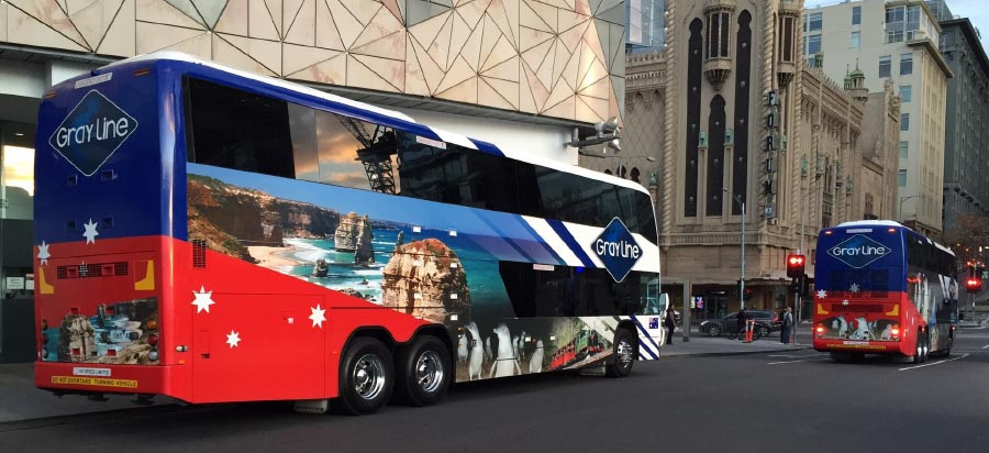 Gray Line double decker coaches departing federation square