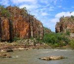 sheer cliffs rising out of river at katherine gorge