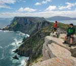 three capes track - walkers looking out from sheer cliffs above ocean